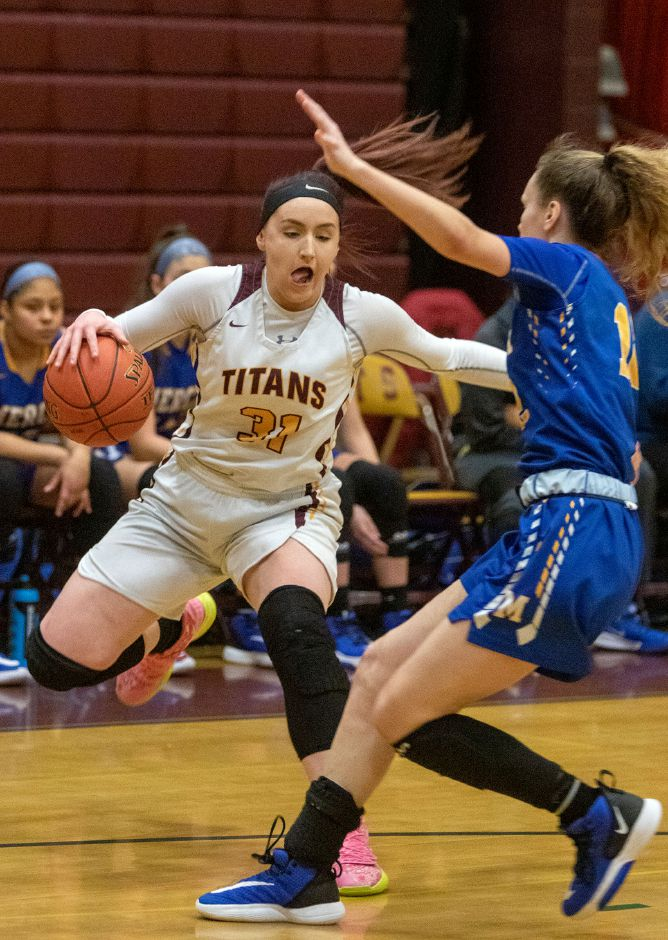 Sheehan's Hayleigh Lagase looks to get by Mercy's Lilly Hedge during the first half at Sheehan High School on Friday, February 14, 2020. Aaron Flaum, Record-Journal