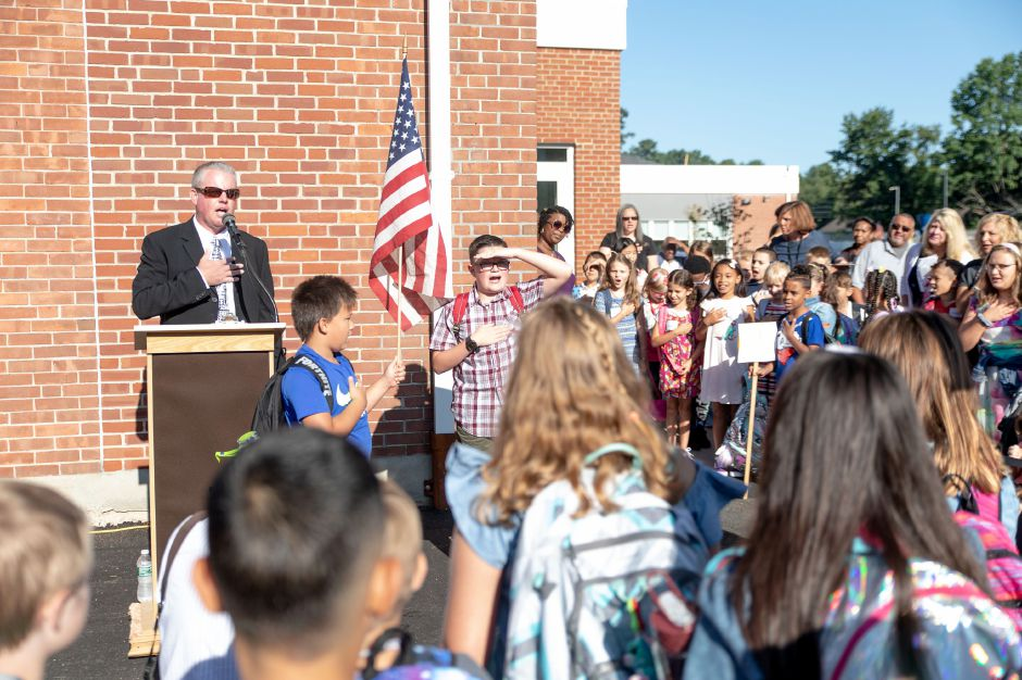 Wheeler Elementary School Principal Andrew Batchelder recites the pledge of allegiance with students on the frist day of school in Plainville on Sept. 3, 2019. | Devin Leith-Yessian/Plainville Citizen