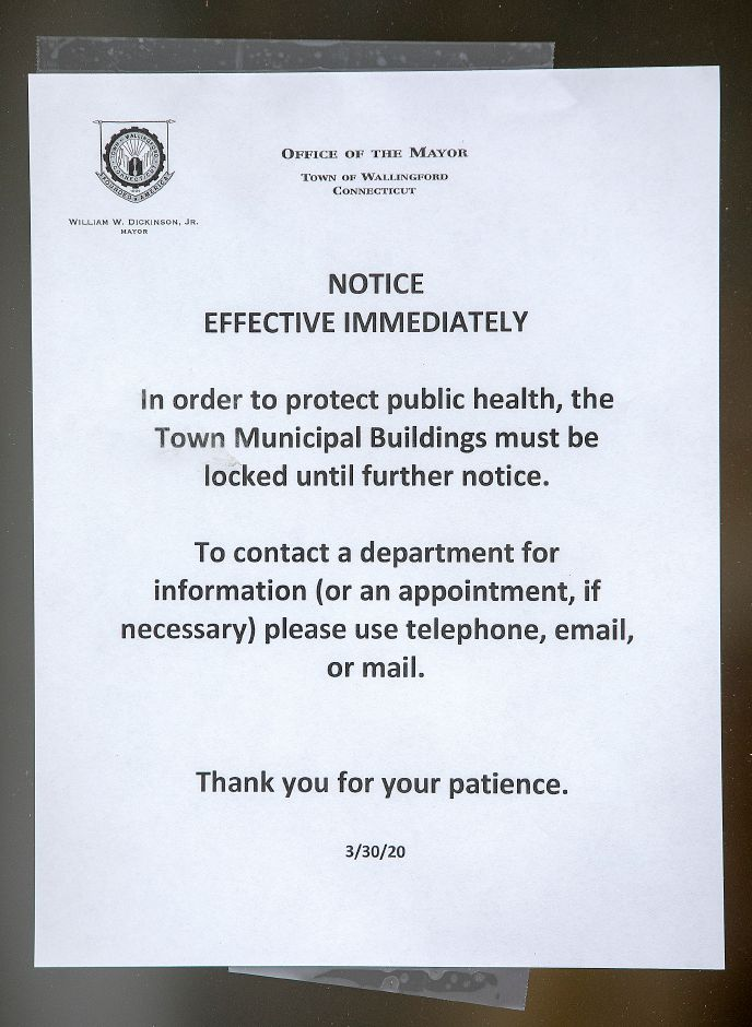 A notice to visitors at Wallingford Town Hall, Mon., Mar. 30, 2020. The doors of town hall have been locked to protect public health. Dave Zajac, Record-Journal