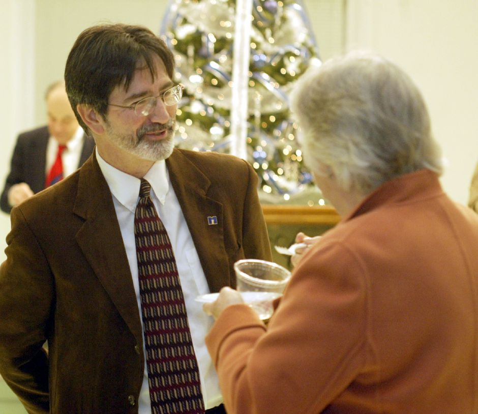 Sean Moore, left, chats with A. Lee Campione at the gala event hosted by the Bicentenial Steering committee at the Curtis Cultural Center in Meriden on Dec. 14, 2006.