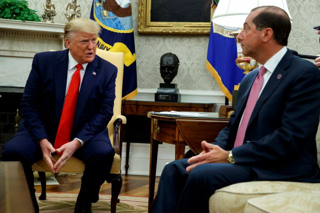 President Donald Trump talks to Secretary of Health and Human Services Alex Azar about a plan to ban most flavored e-cigarettes, in the Oval Office of the White House, Wednesday, Sept. 11, 2019, in Washington. (AP Photo/Evan Vucci)