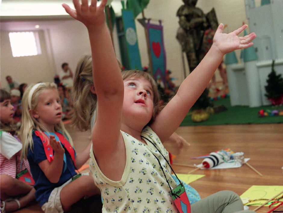 Emma Czaplinski, age 5 and a half from Meriden praises God during a song of praise at a performance to celebrate the last day of Bible School Camp at St Stanislaus Community Center July 16, 1999