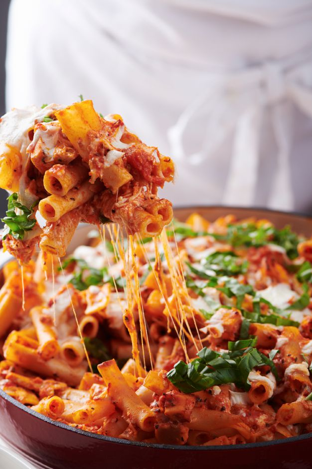 This image shows a recipe for Chicken Parmesan Baked Ziti. More people are cooking at home these days, and when they do eat restaurant food, they're often looking for comfort food, experts say. Other trends include simpler recipes, recipes with fewer ingredients, one-pot meals, sheet-pan meals, finger food and pantry-ingredient recipes, all up significantly year over year. (Cheyenne M. Cohen/Katie Workman via AP)