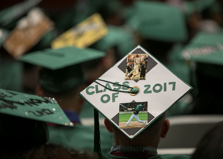 Graduate Jeffrey Massicotte wears a sports themed cap before the start of graduation ceremonies at Maloney High School in Meriden, Tuesday, June 13, 2017. | Dave Zajac, Record-Journal