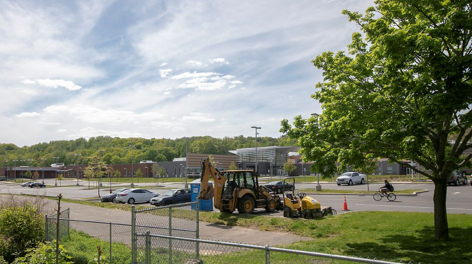 A bicyclist, right, pedals through the Platt High School parking lot near the end of the Meriden Linear Trail, bottom, Tues., May 19, 2020. Dave Zajac, Record-Journal