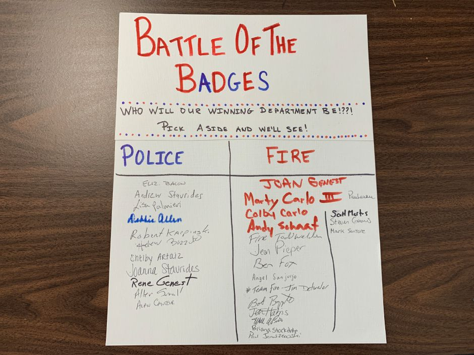 "Blood donors at the ""Battle of the Badges"" were asked to write their name under the team they were supporting: Team Fire or Team Police."