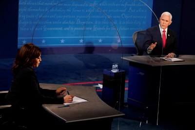Vice President Mike Pence looks at Democratic vice presidential candidate Sen. Kamala Harris, D-Calif., as he answers a question during the vice presidential debate Wednesday, Oct. 7, 2020, at Kingsbury Hall on the campus of the University of Utah in Salt Lake City. (AP Photo/Morry Gash, Pool)