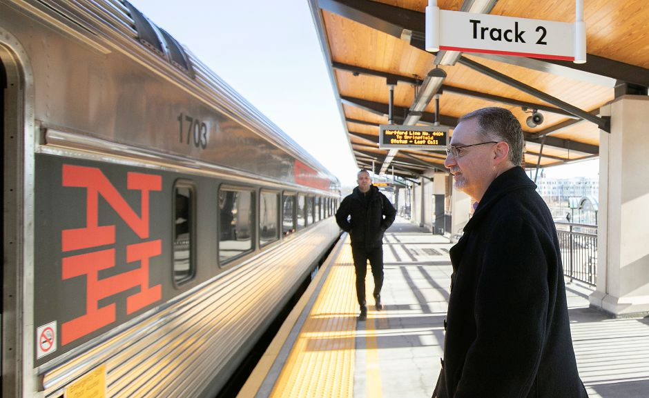 Joseph Geremia, chief financial officer of the Capital Region Development Authority, prepares Friday  to board a train to Hartford from the Meriden train station. Geremia rides the train to work three or four days per week. Dave Zajac, Record-Journal