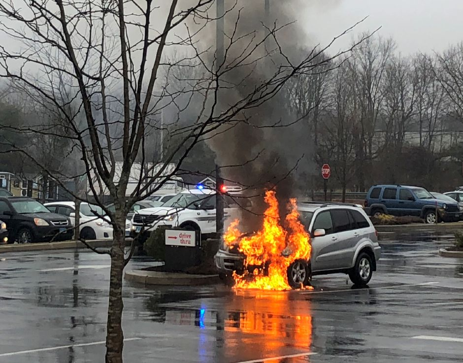 Firefighters respond to car on fire in the Chick-fil-A parking lot in Wallingford Thursday Feb. 13, 2020. | Ron Rainey, Record-Journal