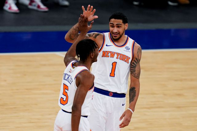 New York Knicks guard Immanuel Quickley (5) celebrates with forward Obi Toppin (1) after scoring the first half of the team