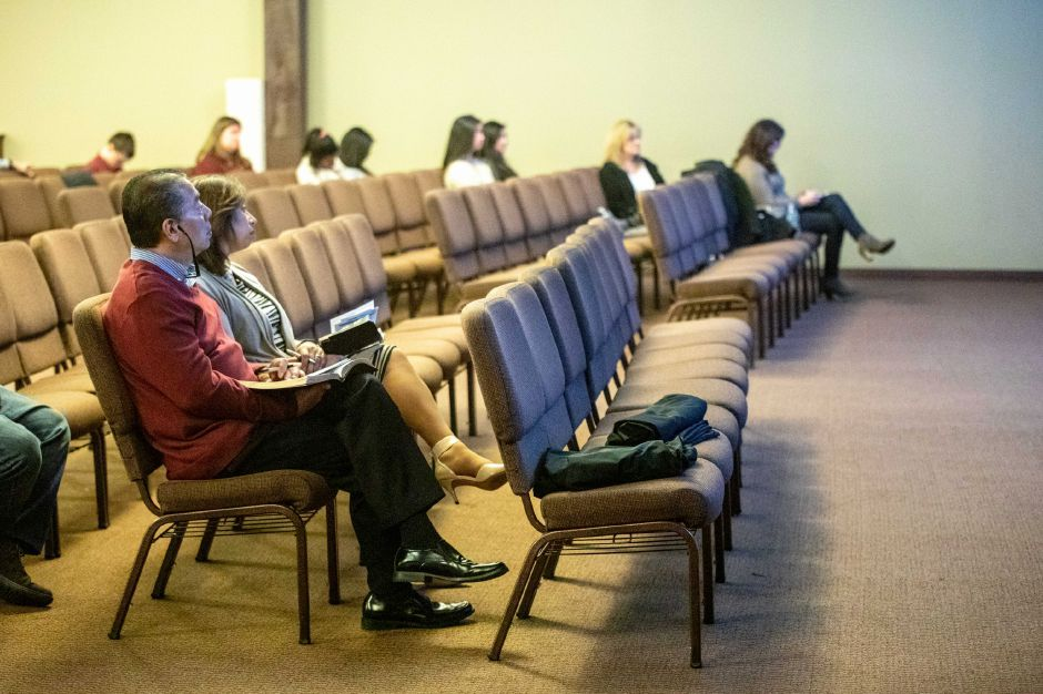 Members of New Life Church in Wallingford listen to Pastor Will Marotti give his sermon on March 15, 2020. The church asked all non-staff members to stay home and watch a live stream of the Sunday service to help stanch the spread of the coronavirus. | Devin Leith-Yessian/Record-Journal
