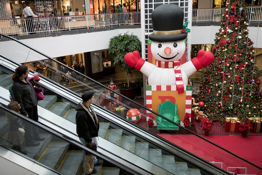 Shoppers look over a Christmas display Tuesday at Westfield Meriden mall.  Dave Zajac, Record-Journal