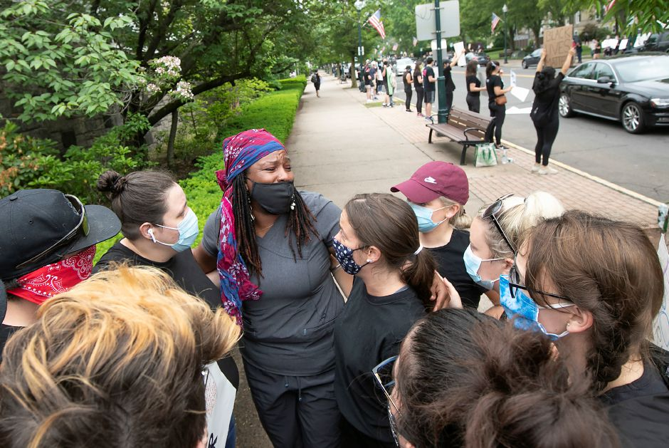 Amy Malachi, of Wallingford, is moved to tears in a group hug during a silent protest in solidarity with the Black Lives Matter movement along South Main Street in Wallingford, Fri., Jun. 5, 2020. Dave Zajac, Record-Journal