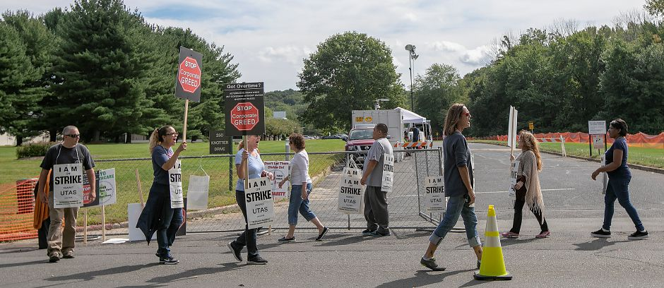 Employees of UTC Aerospace Systems, walk the picket line during a strike in front of the business on Knotter Drive in Cheshire, Monday, Sept. 17, 2018. Dave Zajac, Record-Journal