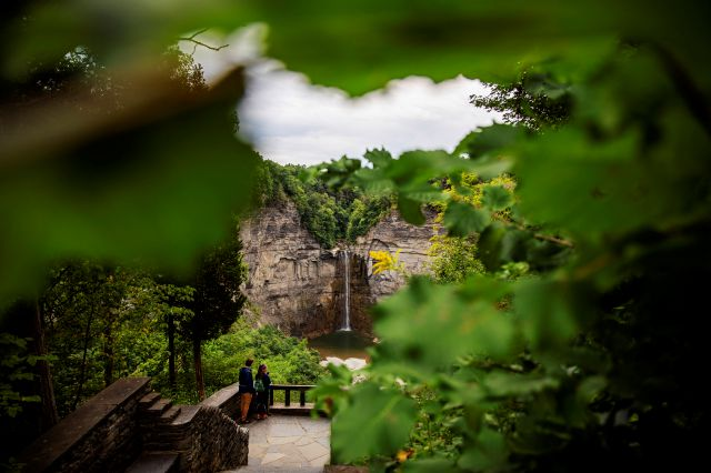 A couple looks out over Taughannock Falls where Krista Johnston and her late husband, Sgt. James Johnston, used to meet for lunch in Trumansburg, N.Y., Sunday, Sept. 1, 2019. The two were high school sweethearts. She liked his easy smile, his jokes, his courtly Southern manner; he first called her Miss Krista and opened doors for her. Soon, they were inseparable, two outdoorsy types, zipping around the woods, splashing in the mud in a four-wheeler, hunting deer. (AP Photo/David Goldman)