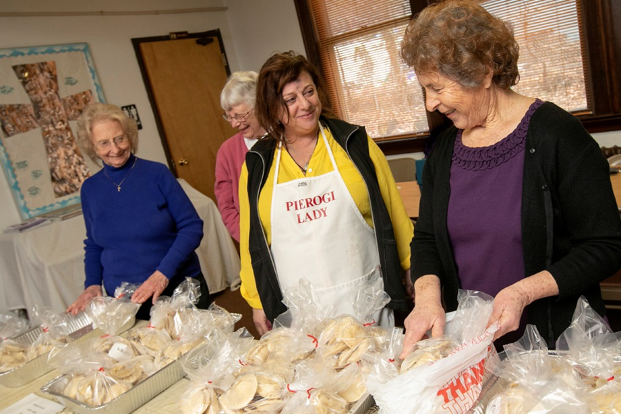 Church members, left to right, Dorothy Riccio, of Wallingford, Cynthia Szymaszek, of Meriden, Carmel-Lynn Brandi, of Wallingford and Mary Henclik, of Wallingford, prepare for the annual pierogi sale at Saint Peter & Paul Church in Wallingford, Wed., Feb. 26, 2020. Dave Zajac, Record-Journal