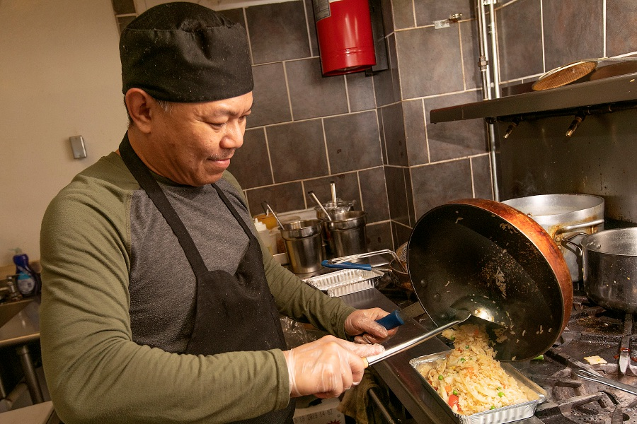 Chef Chan Chaoranguen prepares a chicken fried rice dish at Thai Tanic Cuisine, 784 E. Main St., Meriden, Wed., Jan. 15, 2020. Dave Zajac, Record-Journal