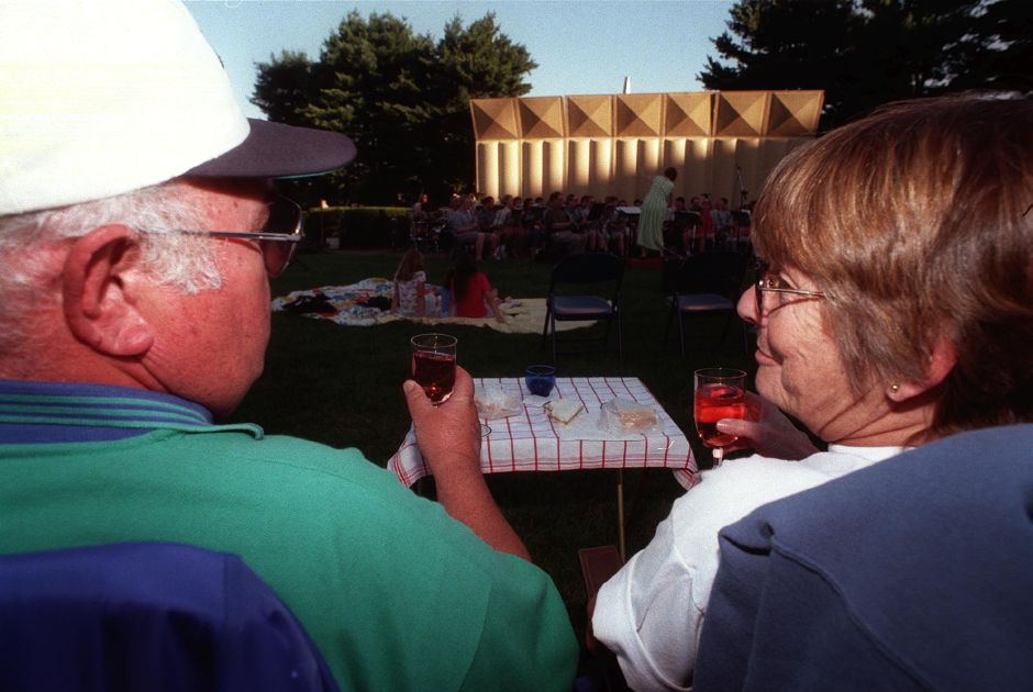 "Bill and Alice Fekeje of Wallingford enjoy a glass of wine while listening to the the ""R"" Band at the Masonic Home Thursday evening July 20, 2000 as part of the free summer concert series."
