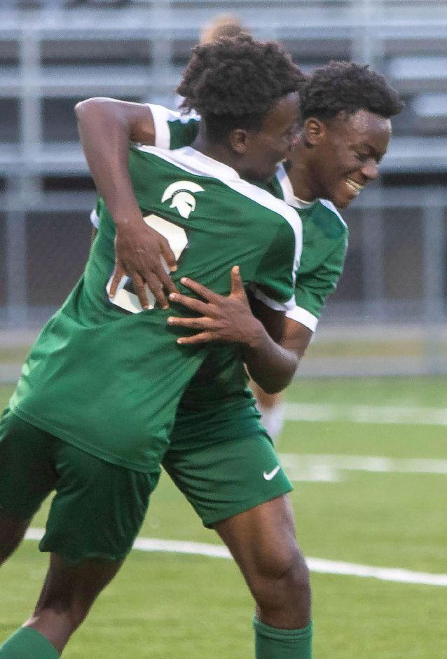 Solomon Owusu, left, scored what proved to be the game-winning goal in the Maloney boys soccer team's 2-1 victory over Berlin on Thursday at Maloney High School. Aaron Flaum, Record-Journal