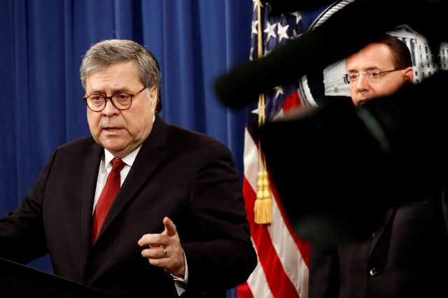 Attorney General William Barr speaks alongside Deputy Attorney General Rod Rosenstein about the release of a redacted version of special counsel Robert Mueller