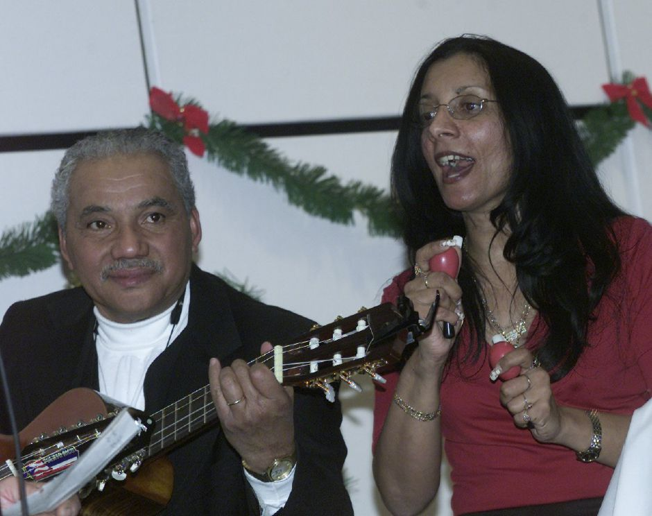 (L) Angel Ferrer and (R) Margarita Santos perform with the St. Rose Hispanic Choir during the Three Kings Day celebration at the Meriden Public Library Sunday Jan. 7, 2001.