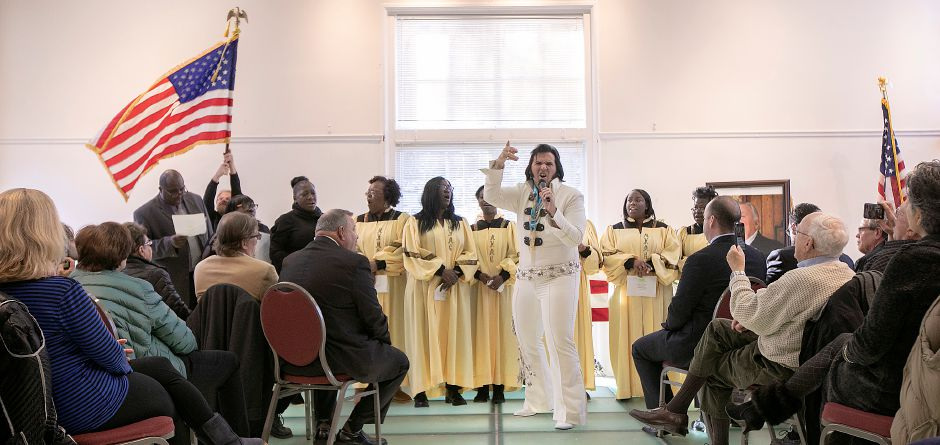 Elvis impersonator Lamar Peters, of NY, performs with choir members from Mount Hebron Baptist Church of Meriden and Ministries of Faith and Deliverance of Hartford during a memorial service for Walter A. Shamock Jr. at the Augusta Curtis Cultural Center in Meriden, Thurs., Dec. 12, 2019. Shamock, a former realtor and Korean War veteran, was a longtime postal worker before he retired and joined the Meriden City Council in 1989. Dave Zajac, Record-Journal
