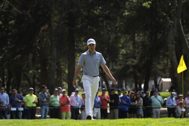 Justin Thomas of the United States walks towards the third green during the second round of the WGC-Mexico Championship golf tournament, at the Chapultepec Golf Club in Mexico City, Friday, Feb. 21, 2020. (AP Photo/Fernando Llano)