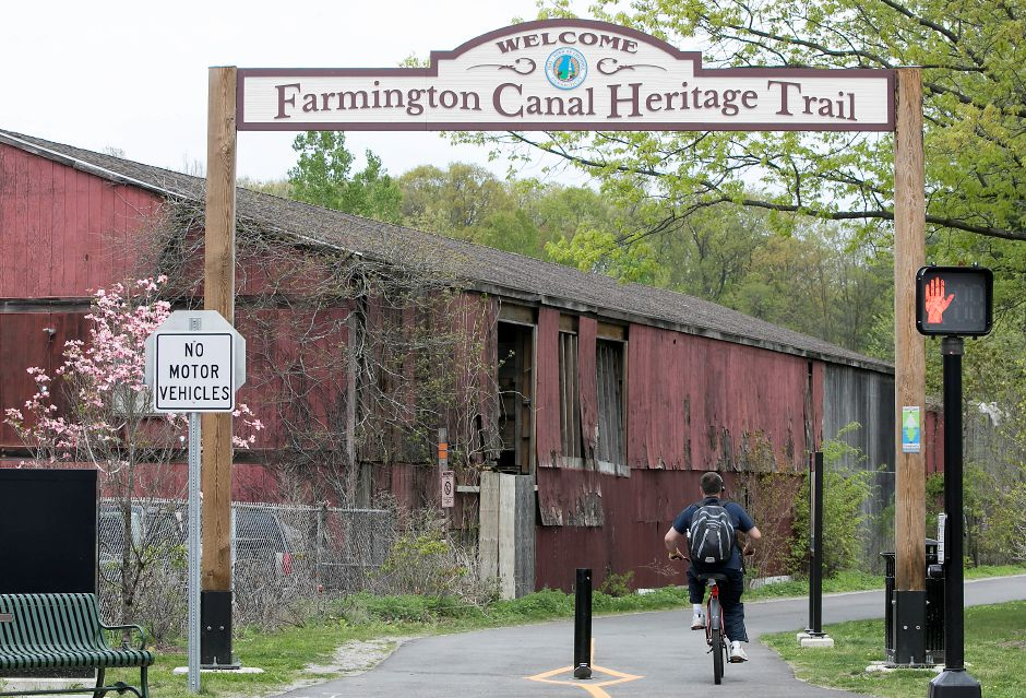 A cyclist heads north on the Farmington Canal Heritage Trail from West Main Street in Cheshire, Thursday, May 10, 2018. Construction continues on a new trail section between Cornwall Avenue and West Main Street. Dave Zajac, Record-Journal