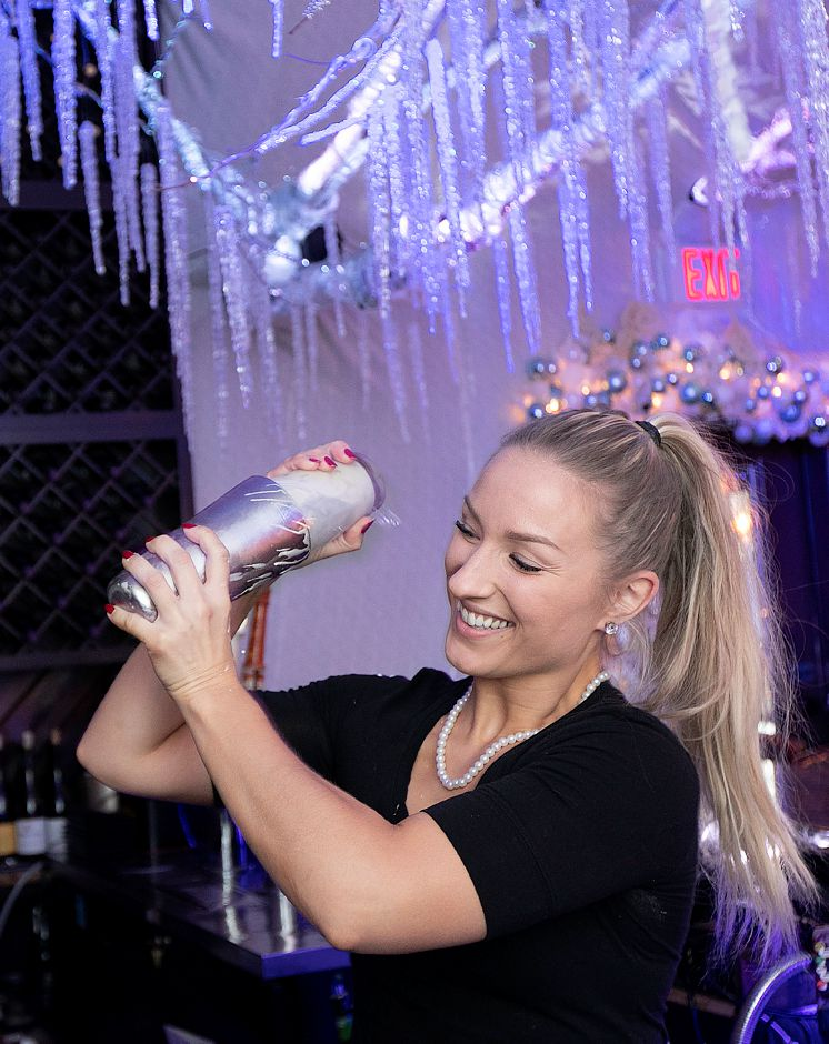 Bartender Alyssa Babon, of Southington, mixes a cocktail at Cava Restaurant on West Street in Southington, Tues., Nov. 20, 2018. The business features an elaborate holiday display annually. Dave Zajac, Record-Journal