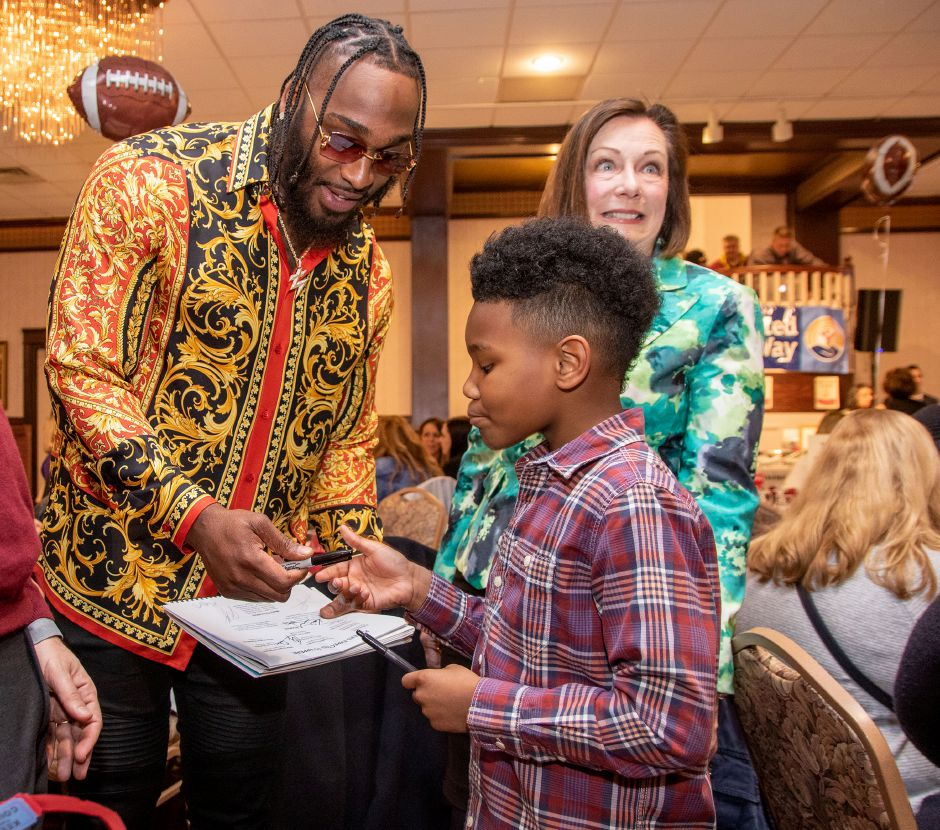 London Preston 9, of Meriden, gets an autograph from Pittsburgh Steelers Tuzar Skipper during the 27th Annual United Way 2020 NFL Players Weekend NFL Players Live Auction and Dinner Buffet at the Zandri's Stillwood Inn in Wallingford onFriday, March 6, 2020. Aaron Flaum, Record-Journal