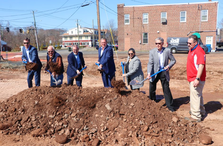Developers and town officials break ground on a $17 million commercial and residential development on Farmington Avenue in Berlin on  Monday. Nadya Korytnikova, Record-Journal