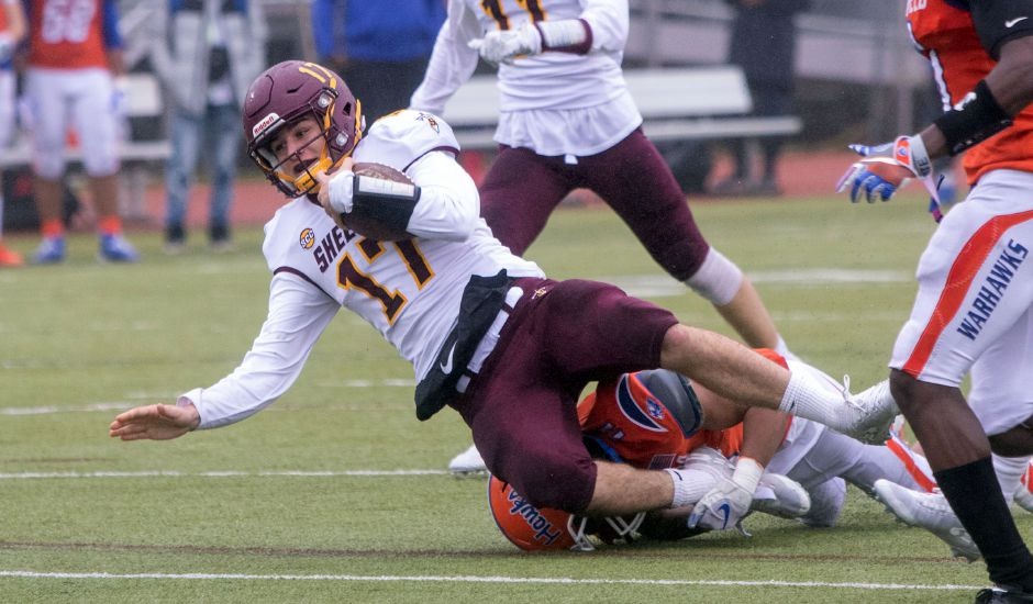 Sheehan quarterback Kyle Simmons gets yardage against Bloomfield during Saturday's Class S championship game. Aaron Flaum, Record-Journal