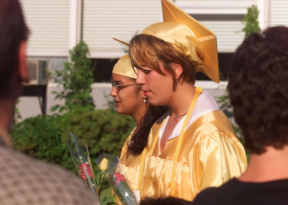 Wilcox Tech class salutatorian Marlyn Medina, left, and valedictorian Marcie Gawel, right, lead the processional during graduation Fri., June 18, 1999.