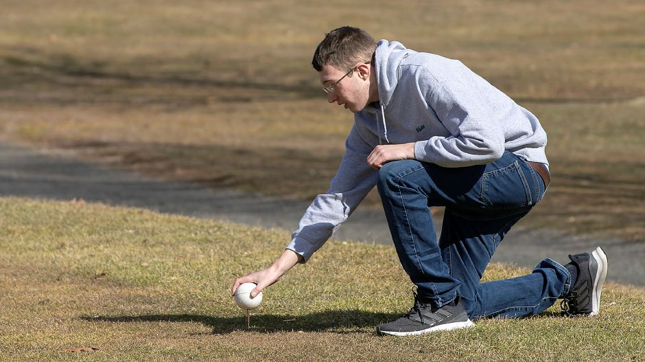Blake Kunst, of Meriden, places a tee marker on the 4th hole at Hunter Golf Course in Meriden, Thurs., Feb. 27, 2020. The 19-year-old diagnosed with Autism Spectrum Disorder is a maintenance worker at the course on Westfield Road. Dave Zajac, Record-Journal