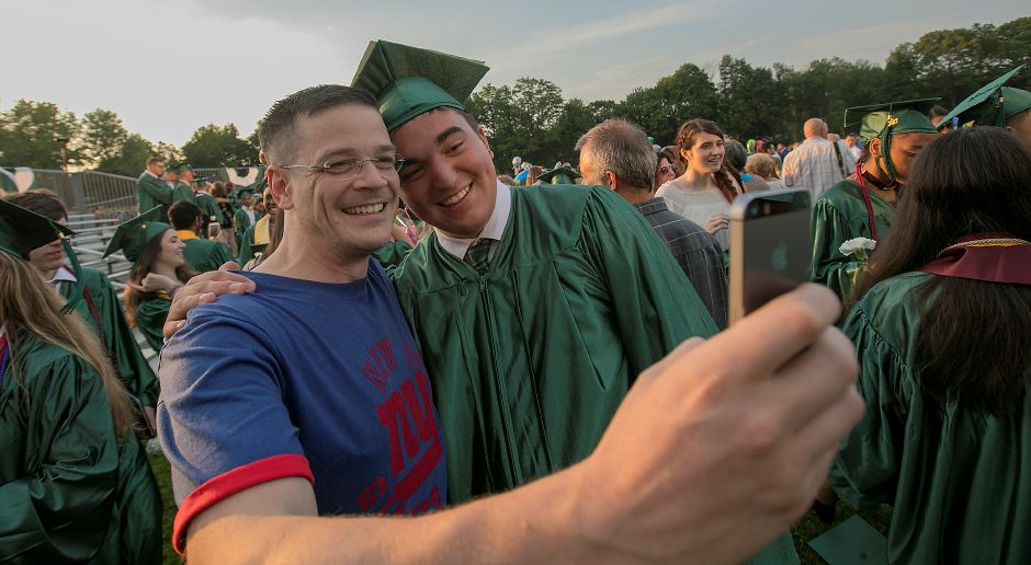 Spanish teacher Randall Dehnel snaps a selfie with with former student and graduate Nicholas Jones at conclusion of graduation ceremonies at Maloney High School in Meriden, Tuesday, June 13, 2017. | Dave Zajac, Record-Journal