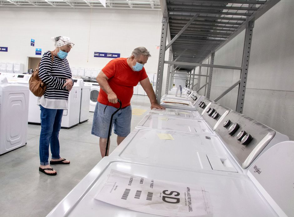 Jim and Julie Ceruti, of Meriden, check out washing machines at Lowe's Outlet in the Meriden Parkade on East Main Street in Meriden during a soft opening on Thursday.