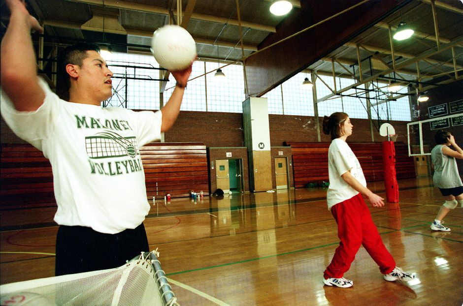 Maloney Girls volleyball coach Victor Rivera with the team during practice Thurs., Oct. 28 1999.