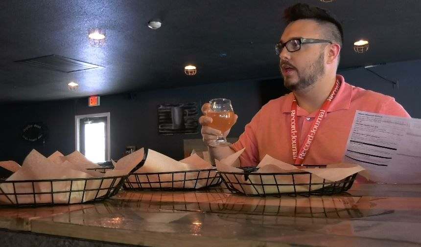 Record-Journal web producer Spencer Davis tests out some pretzels at The Hop Knot, 1169 Meriden-Waterbury Turnpike, Southington. |Ashley Kus, Record-Journal