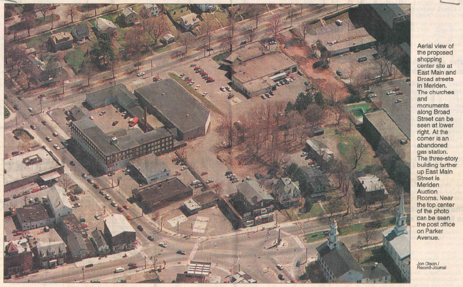 Aerial view in 1997 of the proposed shopping center site at East Main and Broad streets in Meriden. The churches and monuments along Broad Street can be seen at lower right. At the corner is an abandoned gas station. The three-story building farther up East Main Street is Meriden Auction Rooms. Near the top center of the photo can be seen the post officer on Parker Avenue.  | Record-Journal archives