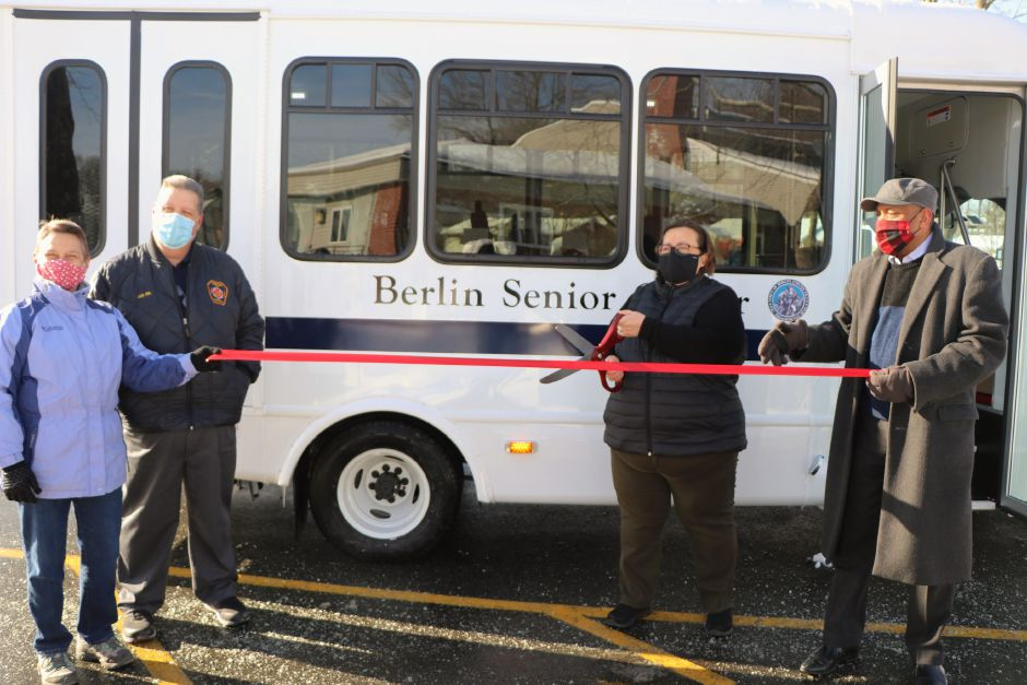 The Berlin Senior Center held a ribbon-cutting ceremony Wednesday for a new bus. From left to right: Senior Center Program Coordinator, Cheryl Schlichting, Senior bus driver, Joe LaVallee, Senior Center Director Tina Doyle, and Town Manager Arosha Jayawickrema | Nadya Korytnikova, Record-Journal