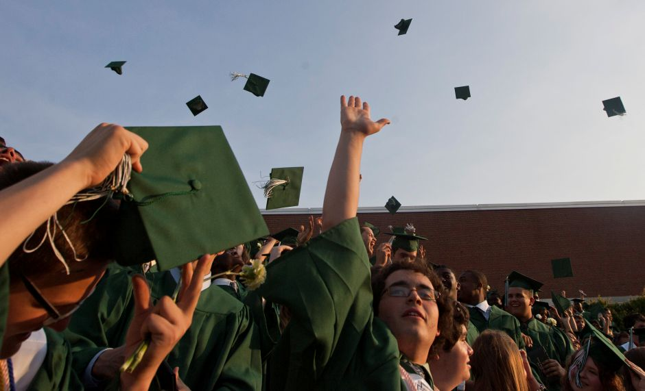 At the end of the graduation ceremony, students toss their caps into the air at Maloney High School Wednesday evening in Meriden, June 20, 2012. (Christopher Zajac / Record-Journla)