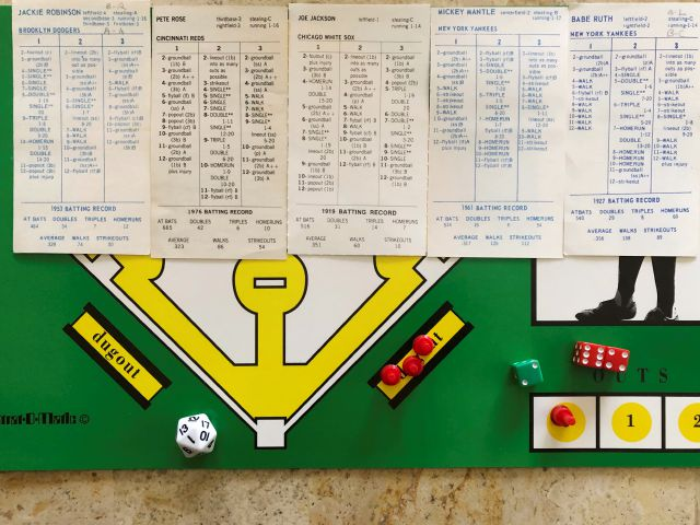 In this April 1, 2020, photo, AP correspondent Dan Sewell in Cincinnati plays in a tournament at home using the Strat-O-Matic baseball board game while self-isolating due to the coronavirus outbreak. With no real baseball being played, fans are getting their fixes with conference call chats, trivia contests and fantasy games. (AP Photo/Dan Sewell)