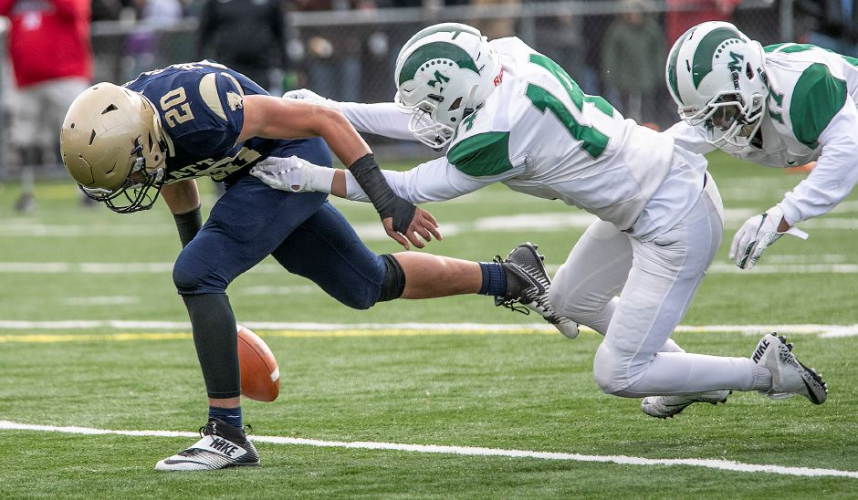 Senior Kody Talento, seen here in action against Platt on Thanksgiving, leads the Maloney defense at linebacker. Dave Zajac, Record-Journal