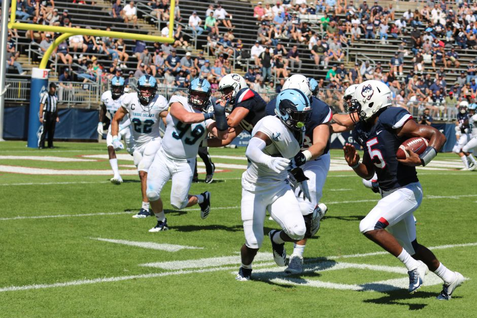 URI linebacker Branyan Javier-Castillo comes up to make the stop on UConn quarterback David Pindell during the Huskies
