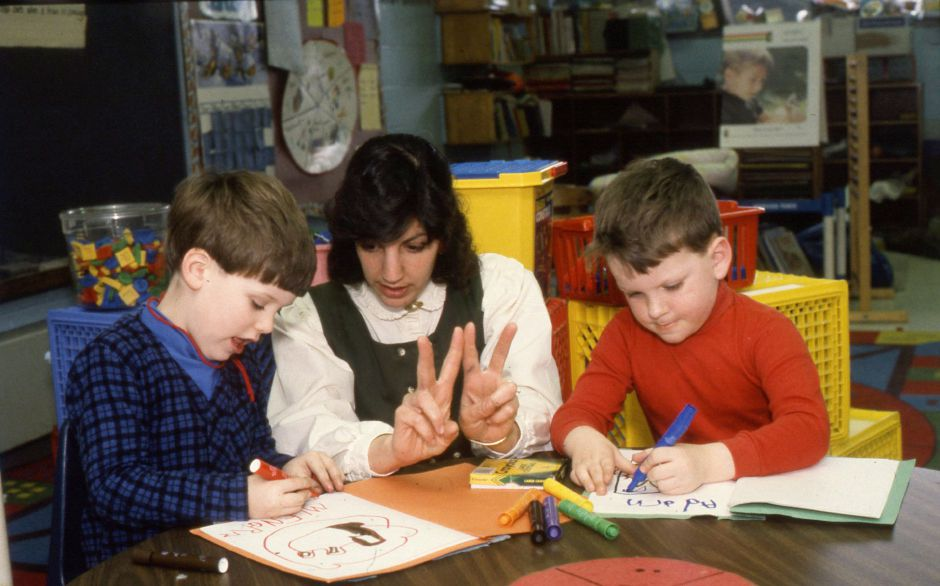 "RJ file photo - Highland School kindergarten students Adam Canning and Adam Grella learn how to write the letter ""W"" using the non-traditional ""whole language"" method of teaching reading, Jan. 1990."