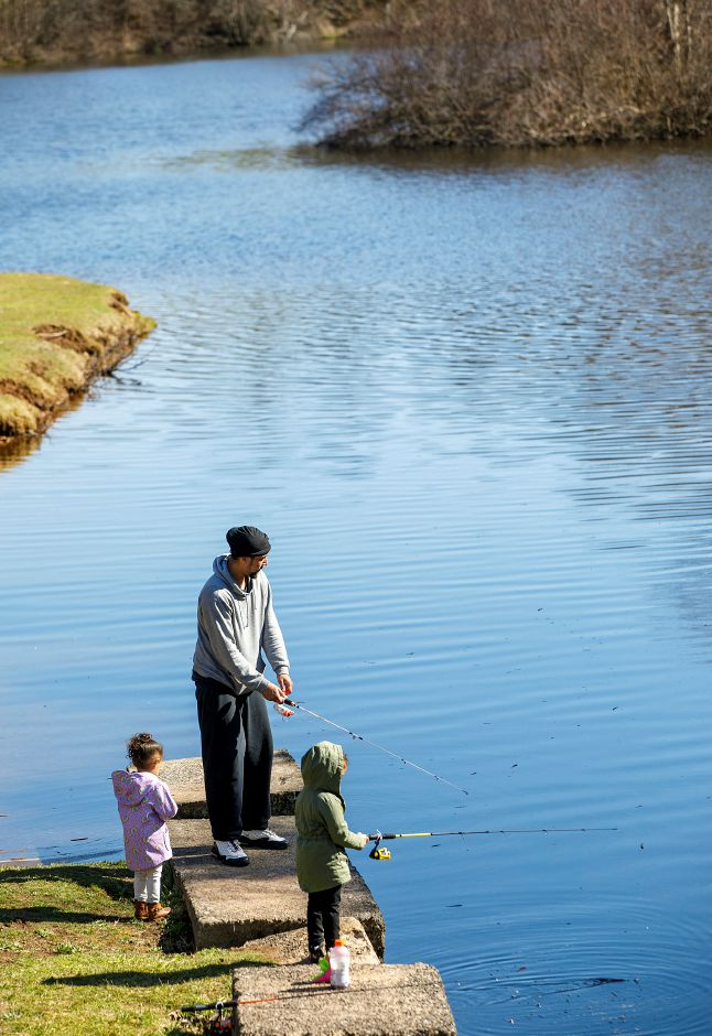 Steve Rodriguez, of New Haven, and daughters, Maya, 2, left, and Lili, 4, enjoy an afternoon of fishing at MacKenzie Reservoir in Wallingford earlier this month.