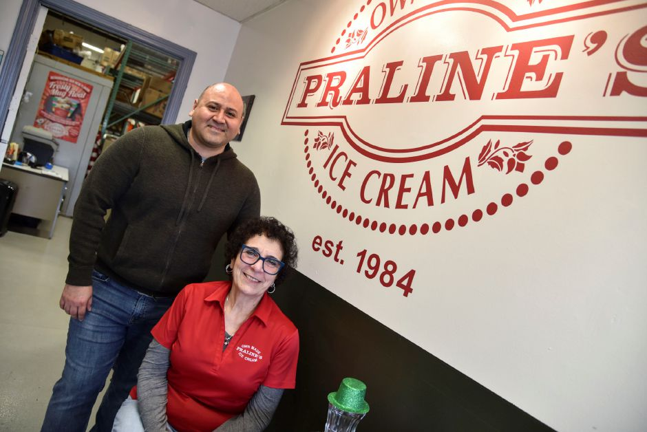 Founder and owner Donna Torre, front, and chief marketing and strategy officer Jalmar Dedios, pose in the Praline