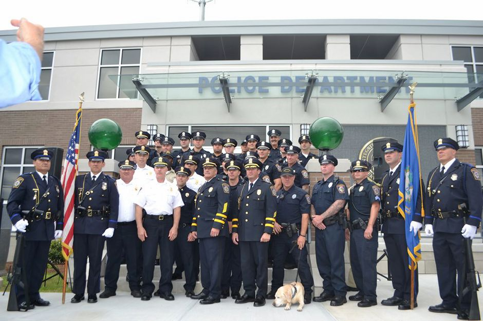 Officers pose in front of the newly-renovated North Haven Police Department at the building's recommissioning ceremony. Photo courtesy of North Haven Police Department
