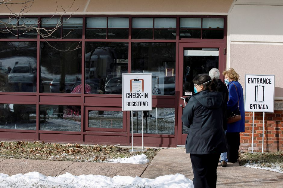 Seniors briefly wait outside before checking in to receive the COVID-19 vaccine at the Wallingford Senior Center in  January.File photo, Record-Journal