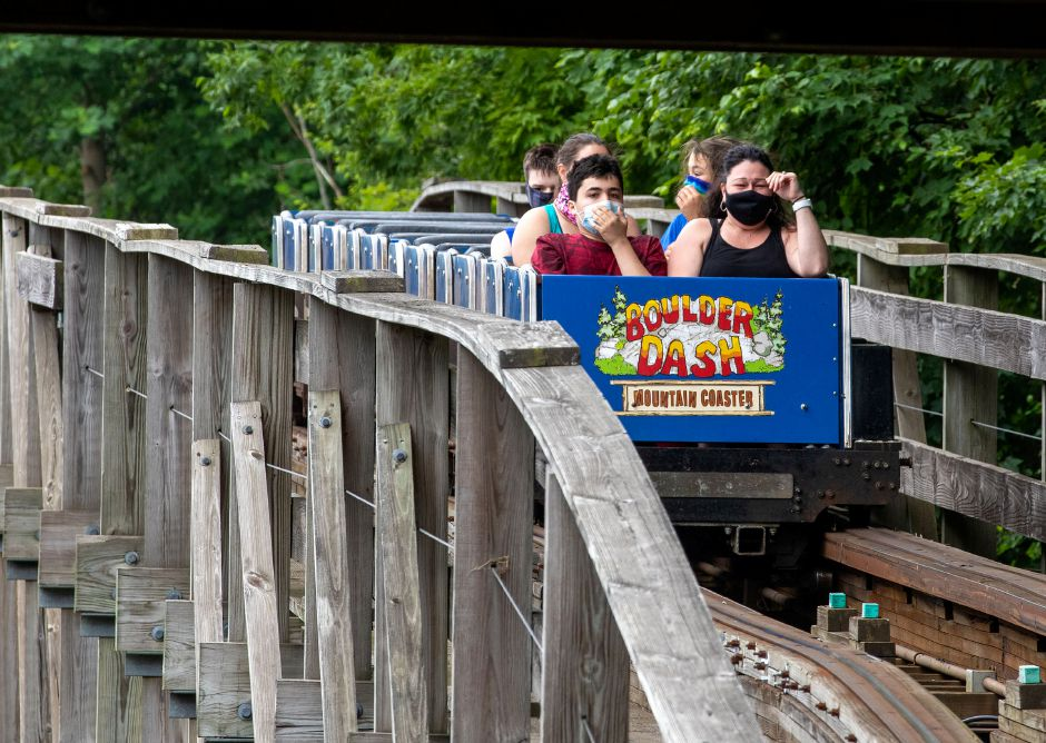 Riders wear their mask as they ride Boulder Dash at Lake Compounce on Tuesday, July 7, 2020. Visitors must wear a mask throughout the park and rides and will be seated by ride attendants for proper distancing. Aaron Flaum, Record-Journal